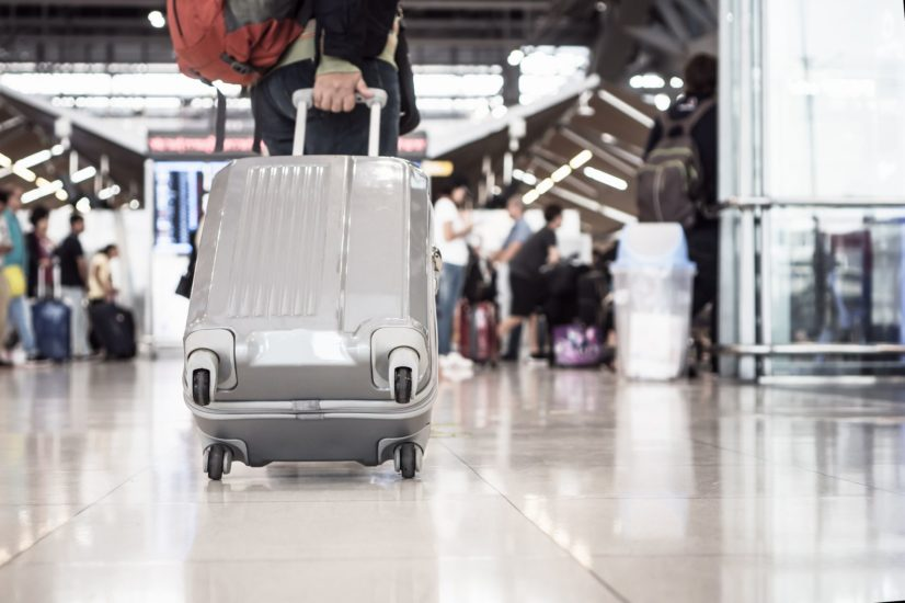 Traveling Luggage Walking At Airport Terminal For Checkin. Trave